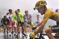 TOPSHOT - France's Julian Alaphilippe, wearing the overall leader's yellow jersey rides up to Foix Prat d'Albis during the fifteen stage of the 106th edition of the Tour de France cycling race between Limoux and Foix Prat d'Albis, in Foix Prat d'Albis on July 21, 2019. (Photo by Marco Bertorello / AFP)