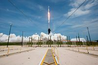 "This NASA photo obtained May 31, 2020 shows a SpaceX Falcon 9 rocket carrying the company's Crew Dragon spacecraft launched from Launch Complex 39A on NASA�s SpaceX Demo-2 mission to the International Space Station with NASA astronauts Robert Behnken and Douglas Hurley onboard, at 3:22 p.m. EDT on May 30, 2020, at NASA�s Kennedy Space Center in Florida. - The Demo-2 mission is the first launch with astronauts of the SpaceX Crew Dragon spacecraft and Falcon 9 rocket to the station as part of the agency�s Commercial Crew Program. (Photo by Bill INGALLS / NASA / AFP) / RESTRICTED TO EDITORIAL USE - MANDATORY CREDIT ""AFP PHOTO /NASA/BILL INGALLS/HANDOUT "" - NO MARKETING - NO ADVERTISING CAMPAIGNS - DISTRIBUTED AS A SERVICE TO CLIENTS"