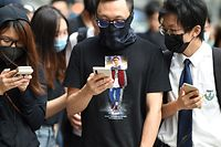 Masked protesters gather outside the High Court premises in support of activist Edward Leung, jailed for taking part in the 2016 Mongkok riots, during an appeal hearing for his period of sentence in Hong Kong on October 9, 2019. - Leading independence activist Leung was jailed for six years on June 2018 for his involvement in the 2016 Lunar New Year riots in Hong Kong's Mongkok district, then one of the city's worst protest violence in decades, as semi-autonomous Hong Kong has been battered by four months of increasingly violent pro-democracy protests sparked by opposition to a now-scrapped bill allowing extraditions to China. (Photo by Mohd RASFAN / AFP)