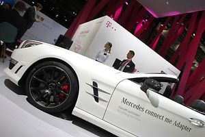 "A connected Mercedes car is pictured at the booth of German telecommunication giant Telekom at the ""Mobility World"" hall on the second press day of the 66th IAA auto show in Frankfurt am Main, western Germany, on September 16, 2015. For the first time, around 30,000 square metres (323,000 square feet) of exhibition floor space are given over to new forms of mobility, from the connected to the self-driving car. 