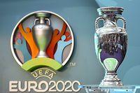 ARCHIV - 21.09.2016, Großbritannien, London: Der EM-Pokal neben dem Logo für die UEFA EURO 2020.  Die Fußball-EM 2020 behält trotz der Verschiebung um einJahr ihren Namen.Das teilte die Europäische Fußball-Union am Donnerstag nach einer Sitzung des Exekutivkomitees mit. Das Turnier in zwölf Ländern war aufgrund der Corona-Pandemie verlegt worden und soll nun vom 11. Juni bis zum 11. Juli 2021 stattfinden. Foto: Facundo Arrizabalaga/EPA/dpa +++ dpa-Bildfunk +++