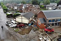 Cars and debris is piled up at in a residential area destroyed by recent flood waters in Trooz on 16 July 2021. - The death toll from devastating floods in Europe soared to at least 126 on Friday, most in western Germany where emergency responders were frantically searching for missing people. (Photo by ERIC LALMAND / BELGA / AFP) / Belgium OUT