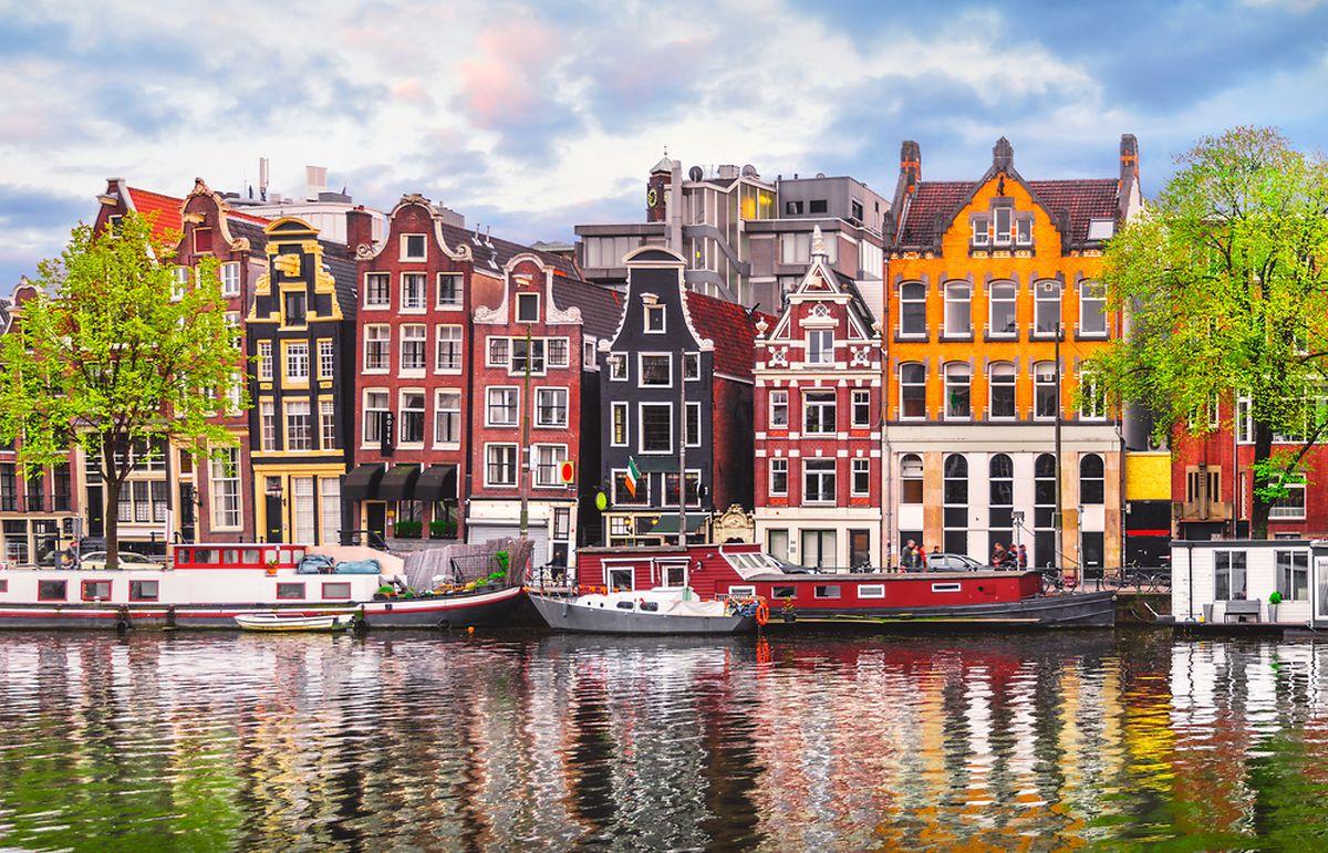 Amsterdam 'dancing houses' over river Amstel (Shutterstock)