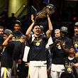 CLEVELAND, OH - JUNE 08: Klay Thompson #11 of the Golden State Warriors celebrates with the Larry O'Brien Trophy after defeating the Cleveland Cavaliers in Game Four of the 2018 NBA Finals at Quicken Loans Arena on June 8, 2018 in Cleveland, Ohio. NOTE TO USER: User expressly acknowledges and agrees that, by downloading and or using this photograph, User is consenting to the terms and conditions of the Getty Images License Agreement.   Gregory Shamus/Getty Images/AFP == FOR NEWSPAPERS, INTERNET, TELCOS & TELEVISION USE ONLY ==