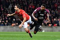 Metz's Senegalese forward Habib Diallo (L) heads a ball and scores next to Nimes' French defender Pablo Martinez during the French L1 football match between Nimes (NO) and Metz (FCM) on November 30, 2019, at the Costiere Stadium in Nimes, southern France. (Photo by GERARD JULIEN / AFP)