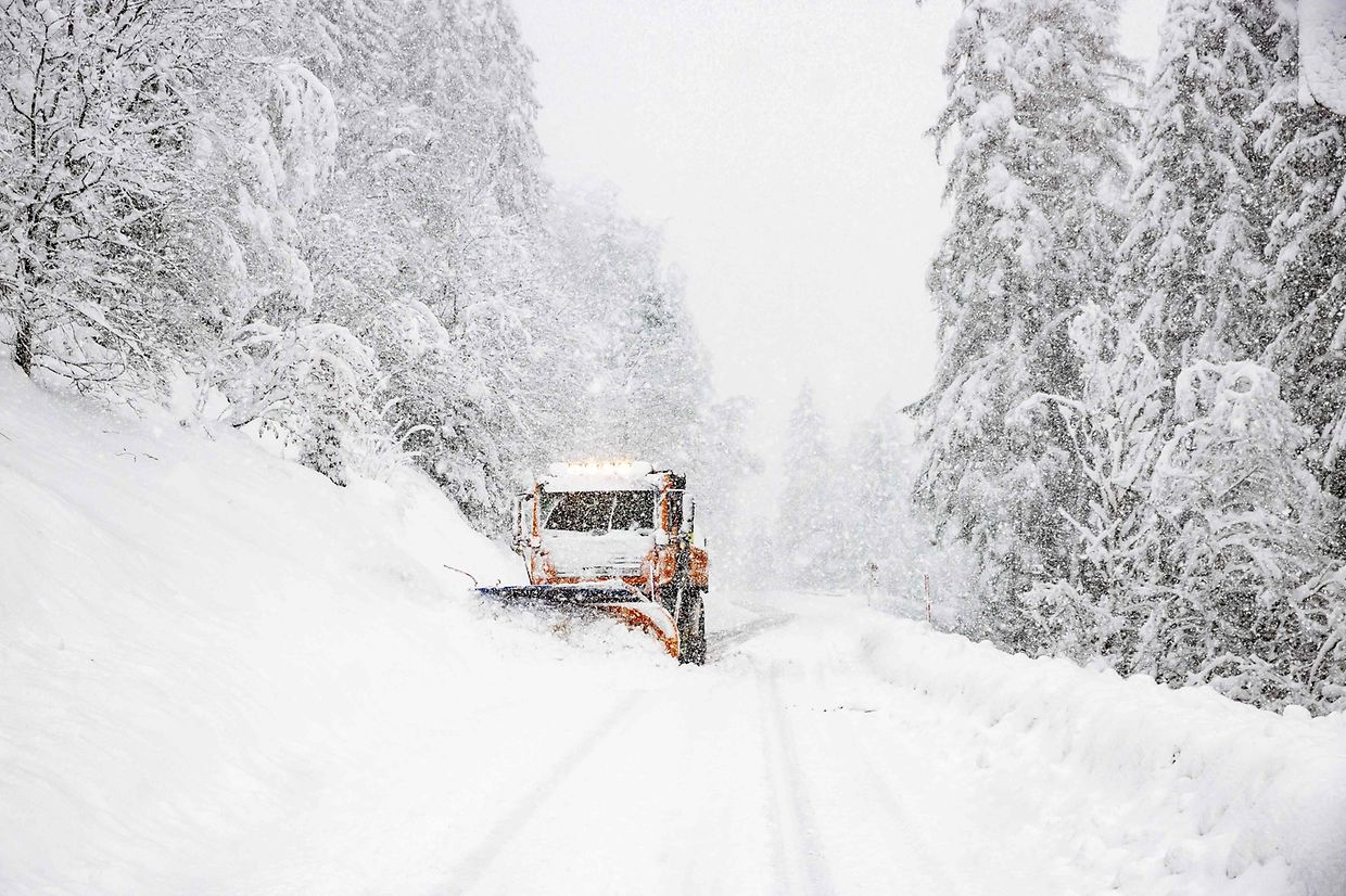 A vehicle removes snow near Lienz in East Tyrol, Austria on December 5 2020. - In East Tyrol and Upper Carinthia, the snow cover grew by around 50 to 70 centimetres from Friday to Saturday. In some places there were red and thus highest weather warnings. (Photo by Johann GRODER / various sources / AFP) / Austria OUT