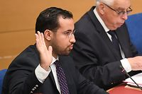 "(FILES) In this file photo taken on September 19, 2018 Former Elysee senior security officer Alexandre Benalla raises his hand as he takes the oath before a Senate committee in Paris. - Benalla has been placed under police custody, suspected of ""forgery and falsification"" in the case of his diplomatic passports, AFP reported on January 17, 2019. (Photo by Alain JOCARD / AFP)"