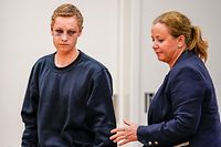 """CORRECTION - Terror suspected Philip Manshaus and his lawyer Unni Fries arrive for a hearing at an Oslo courthouse on August 12, 2019 in Norway. - Norwegian 21-year old Philip Manshaus, is formally suspected of murder in the death of his 17-year-old stepsister, and of a """"terrorist act"""" at the Al-Noor mosque on August 10, 2019, police said in a statement. (Photo by Cornelius POPPE / NTB Scanpix / AFP) / Norway OUT / �The erroneous mention[s] appearing in the metadata of this photo by Cornelius Poppe has been modified in AFP systems in the following manner: [terror suspected] instead of [terror charged]. Please immediately remove the erroneous mention[s] from all your online services and delete it (them) from your servers. If you have been authorized by AFP to distribute it (them) to third parties, please ensure that the same actions are carried out by them. Failure to promptly comply with these instructions will entail liability on your part for any continued or post notification usage. Therefore we thank you very much for all your attention and prompt action. We are sorry for the inconvenience this notification may cause and remain at your disposal for any further information you may require.�"""