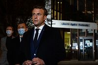 French President Emmanuel Macron (R), flanked by French Interior Minister Gerald Darmanin (2L), speaks to the press in front of a middle school in Conflans Saint-Honorine, 30kms northwest of Paris, on October 16, 2020, after a teacher was decapitated by an attacker who has been shot dead by policemen. - French anti-terror prosecutors said on October 16 they were investigating an assault in which a man was decapitated on the outskirts of Paris and the attacker shot by police. The attack happened at around 5 pm (1500 GMT) near a school in Conflans Saint-Honorine, a western suburb of the French capital. The man who was decapitated was a history teacher who had recently shown caricatures of the Prophet Mohammed in class. French prosecutors are treating the attack as a terror incident, which coincides with the trial of alleged accomplices of the 2015 Charlie Hebdo attackers and comes weeks after a man injured two people he thought worked for the magazine. (Photo by ABDULMONAM EASSA / POOL / AFP)