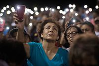People react during a prayer and candle vigil organized by the city, after a shooting left 20 people dead at the Cielo Vista Mall Wal-Mart in El Paso, Texas, on August 4, 2019. - A shooting at a Walmart store in Texas left multiple people dead. At least one suspect was taken into custody after the shooting in the border city of El Paso, triggering fear and panic among weekend shoppers as well as widespread condemnation. It was the second fatal shooting in less than a week at a Walmart store in the US and comes after a mass shooting in California last weekend. (Photo by Mark RALSTON / AFP)