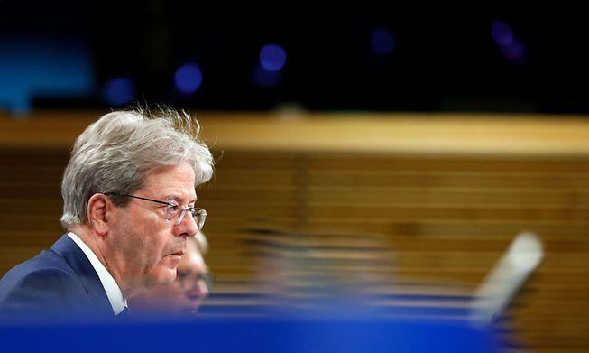 EU economy commissioner Paolo Gentiloni speaks at a news conference in Brussels on Wednesday about the bloc's budget outlook.