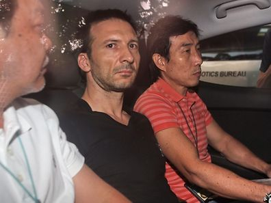 Belgian financial executive Philippe Graffart (middle) charged with strangling 5-year-old son in Singapore