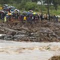 Schoolchildren are stranded across a collapsed bridge in Chimanimani, southeast of Harare, Zimbabwe, Monday, March 18, 2019. (AP Photo/Tsvangirayi Mukwazhi) |