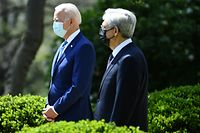 """US President Joe Biden arrives with Attorney General Merrick Garland to speak about gun violence prevention in the Rose Garden of the White House in Washington, DC, on April 8, 2021. - Biden unveiled measures aimed at curbing rampant US gun violence, especially seeking to prevent the spread of untraceable """"ghost guns."""" (Photo by Brendan Smialowski / AFP)"""