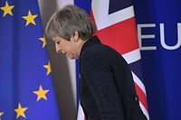 TOPSHOT - British Prime Minister Theresa May walks after holding a press conference on March 22, 2019, on the first day of an EU summit focused on Brexit, in Brussels. - European Union leaders meet in Brussels on March 21 and 22, for the last EU summit before Britain's scheduled exit of the union. (Photo by Emmanuel DUNAND / AFP)