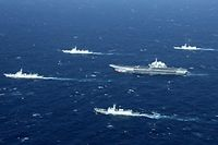 (FILES) This aerial file photo taken on January 2, 2017 shows a Chinese Navy formation, including the aircraft carrier Liaoning (C), during military drills in the South China Sea. - US Secretary of State Mike Pompeo said on July 13, 2020 the United States would treat Beijing's pursuit of resources in the dispute-rife South China Sea as illegal, ramping up support for Southeast Asian nations and triggering a furious response from Beijing. (Photo by STR / AFP) / China OUT