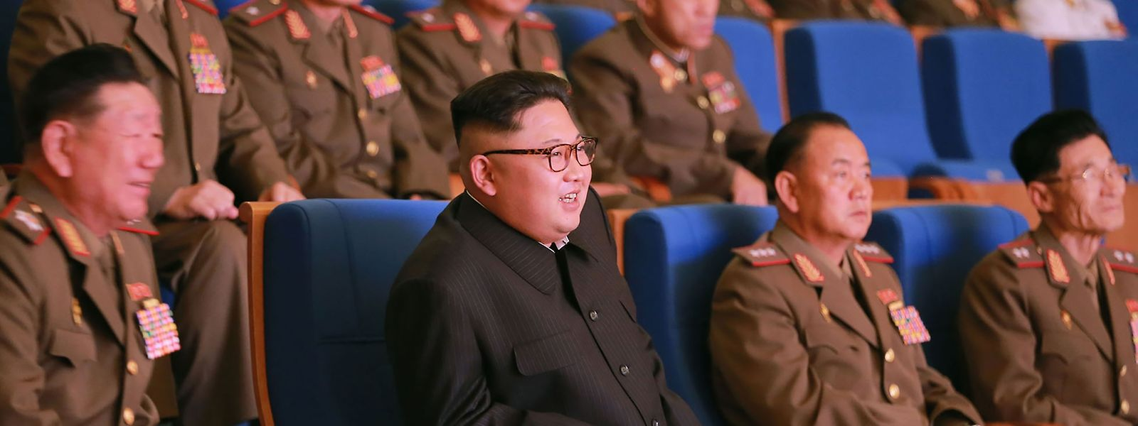 This undated picture released from North Korea's official Korean Central News Agency (KCNA) on July 16, 2016 shows North Korean leader Kim Jong-Un (C) watching an art performance staged by the amateur art groups of the Korean People's Army (KPA) units in Pyongyang.
