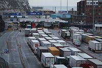 "(FILES) In this file photo taken on March 19, 2018 Lorries queue up at the port of Dover on the south coast of England. - Preparedness in Britain for a no-deal Brexit remains ""at a low level"", with logjams at Channel ports threatening to impact drug and food supplies, according to government assessments released September 11, 2019. British MPs voted last week to force the government to publish the no-deal ""Operation Yellowhammer"" document, which also warns of ""public disorder"" in such a scenario. Britain's plan for no checks at the Irish border would likely ""prove unsustainable due to significant economic, legal and biosecurity risks"", it said, adding that it could lead to a black market developing in border communities, with dissident groups expected to capitalise. (Photo by Daniel LEAL-OLIVAS / AFP)"
