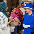 Britain's Queen Elizabeth II meets members of the community affected by the Grenfell Tower disaster during a visit to the Westway Sports Centre which is providing temporary shelter for those who have been made homeless, in west London on June 16, 2017. / AFP PHOTO / POOL / Dominic Lipinski