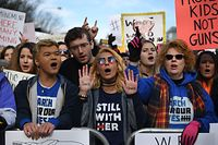 People arrive for the March For Our Lives rally against gun violence in Washington, DC on March 24, 2018. Galvanized by a massacre at a Florida high school, hundreds of thousands of Americans are expected to take to the streets in cities across the United States on Saturday in the biggest protest for gun control in a generation. / AFP PHOTO / JIM WATSON
