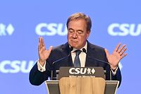Christian Democratic Union (CDU) leader and chancellor candidate Armin Laschet reacts as he addresses a congress of the CDU's sister party Christian Social Union CSU in Nuremberg, southern Germany, on September 11, 2021. (Photo by CHRISTOF STACHE / AFP)