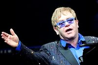 This picture taken on November 25, 2012 shows pop-rock balladeer Elton John performing at his concert in Wukesong Stadium in Beijing. Elton dedicated his Beijing show to Chinese dissident Ai Weiwei -- a controversial move the artist said on November 26 was unlikely to make the nation's cultural minders happy.   CHINA OUT     AFP PHOTO