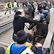 "(FILES) In this file video grab made on January 7, 2018 shows a man (C) believed to be Christophe Dettinger as he takes a boxing stance while clashing with riot police during a demonstration by ""Gilets Jaunes"" anti-government protestors on a bridge leading to the National Assembly in Paris on January 5, 2019. - Two famous ""yellow vests"" figures will be judged this week in Paris: the first, Christophe Dettinger, will appear on February 13, 2019 for boxing gendarmes on a bridge and the second, Eric Drouet, will be judged on February 15, 2019 for the organization of a demonstration ""without authorization"". (Photo by - / AFP)"