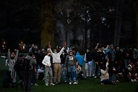 Bystanders and demonstrators gesture at the 'Bois de la Cambre' park, in Brussels, on April 2, 2021, a day after an unauthorised rally for a fake concert announced on social media as an April Fool's Day prank. - Riot police are deployed to a Brussels city park for a second evening, but are faced with much fewer people. Police on horseback and using water cannon charged a crowd of up to 2,000 people gathered in a Brussels park on April 1, 2021, for a fake concert announced on social media as an April Fool's Day prank. (Photo by JOHN THYS / AFP)