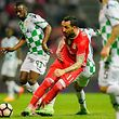 Moreirense's Ousmane Drame (L) competes for the ball with Benfica Kostas Mitroglou (C) during their Portuguese First League soccer match, held at Stadium Comendador Joaquim de Almeida Freitas,  Moreira de Conegos, 09 April 2017. OCTAVIO PASSOS/LUSA