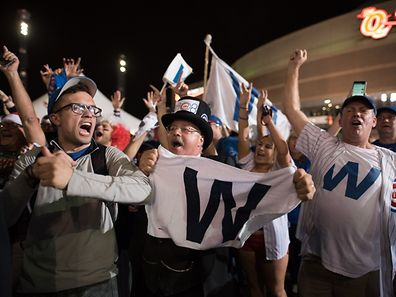 Cubs fans celebrate after the Chicago Cubs defeat the Cleveland Indians in game 7 of the World Series