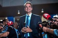 Greece's newly elected Prime Minister and leader of conservative New Democracy party Kyriakos Mitsotakis, speaks to the press outside the party's headquarters after the official results of the elections, in Athens on July 7, 2019. - Greek Prime Minister Alexis Tsipras conceded defeat in a general election to Kyriakos Mitsotakis, head of the conservative New Democracy party, his office said. Leftist Tsipras called Mitsotakis to congratulate him, a source in the prime minister's office told AFP, with New Democracy on track to score a landslide victory according to early results. (Photo by LOUISA GOULIAMAKI / AFP)