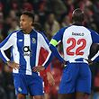 Porto's Brazilian defender Eder Militao (L) and Porto's Portuguese midfielder Danilo Pereira (R) react to their defeat on the pitch after the UEFA Champions League quarter-final, first leg football match between Liverpool and FC Porto at Anfield stadium in Liverpool, north-west England on April 9, 2019. - Liverpool won the game 2-0. (Photo by Paul ELLIS / AFP)
