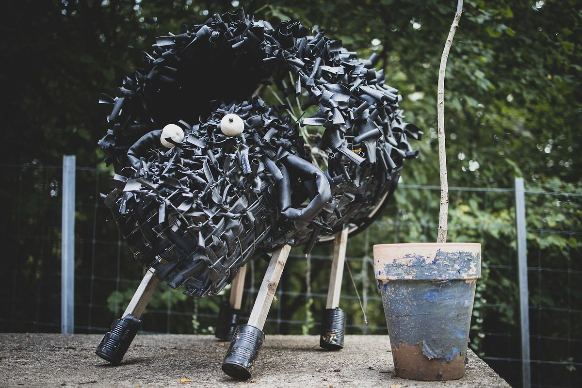An art piece made for the garden by the children from upcycled items such as bicycle tyres and tin cans