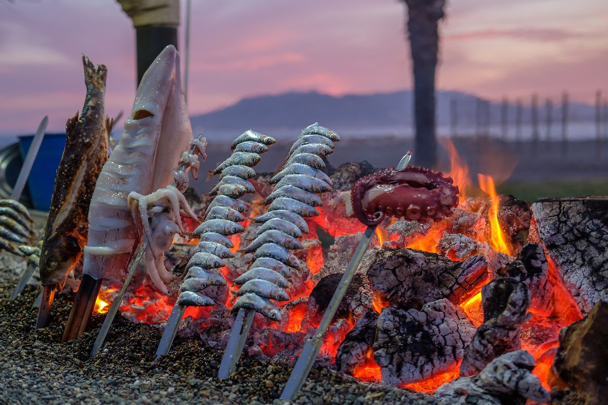 Sardines Espetos cooked on an open fire is a culinary speciality of Malaga