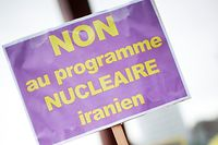 "A member of the Iranian opposition holds a banner saying"" no to the Iranian nuclear program"" in front of the United Nations headquarters in Geneva, December 6, 2010.  Six world powers are holding their first talks with Iran in more than a year on Monday, hoping the meeting will lead to new negotiations over a nuclear program the West believes is aimed at making atom bombs. REUTERS/Valentin Flauraud (SWITZERLAND - Tags: POLITICS CIVIL UNREST)"