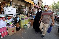 Iranians shop at the Molavi bazaar in southern Tehran on June 20, 2021. (Photo by ATTA KENARE / AFP)