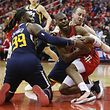 HOUSTON, TEXAS - APRIL 17: Chris Paul #3 of the Houston Rockets calls a timeout as he battles with Jae Crowder #99 of the Utah Jazz and Joe Ingles #2 during Game Two of the first round of the 2019 NBA Western Conference Playoffs between the Houston Rockets and the Utah Jazz at Toyota Center on April 17, 2019 in Houston, Texas. NOTE TO USER: User expressly acknowledges and agrees that, by downloading and or using this photograph, User is consenting to the terms and conditions of the Getty Images License Agreement.   Bob Levey/Getty Images/AFP == FOR NEWSPAPERS, INTERNET, TELCOS & TELEVISION USE ONLY ==