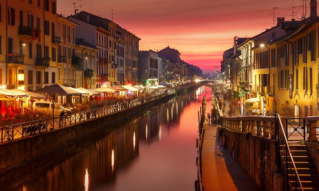 Milan's Naviglio Grande is home to multiple canal-side bars and cafes, perfect for watching the sunset