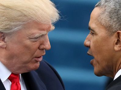 FILE PHOTO: U.S. President Barack Obama (R) greets President-elect Donald Trump at inauguration ceremonies swearing in Trump as president on the West front of the U.S. Capitol in Washington, U.S., January 20, 2017. REUTERS/Carlos Barria/File Photo
