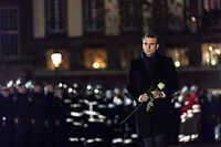 French President Emmanuel Macron is about to lay a white rose at a monument near the Christmas market in Strasbourg's Kleber square, used as a makeshift memorial for the victims of the December 11 attack who killed four people. - The alleged gunman who had been on the run since allegedly killing four people at Strasbourg's popular Christmas market has been shot dead by police on December 13 in the Neudorf neighbourhood of Strasbourg. (Photo by Jean-Francois Badias / AFP)