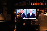 NEW YORK CITY - OCTOBER 22: The final debate between President Donald Trump and Joe Biden plays on a restaurant television in Manhattan on October 22, 2020 in New York City. The last debate was a much more subdued event between the two presidential candidates before the November 3rd election.   Spencer Platt/Getty Images/AFP == FOR NEWSPAPERS, INTERNET, TELCOS & TELEVISION USE ONLY ==