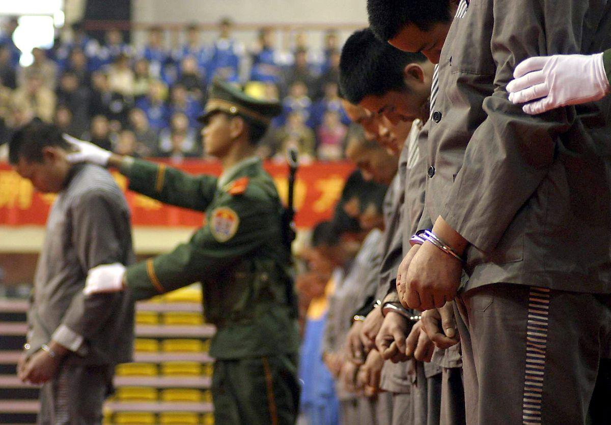 Chinesische Gefangene bei ihrer Hinrichtung.