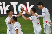 Spain's midfielder Pablo Sarabia (C) celebrates scoring his team's third goal during the UEFA EURO 2020 Group E football match between Slovakia and Spain at La Cartuja Stadium in Seville on June 23, 2021. (Photo by Julio MUNOZ / POOL / AFP)