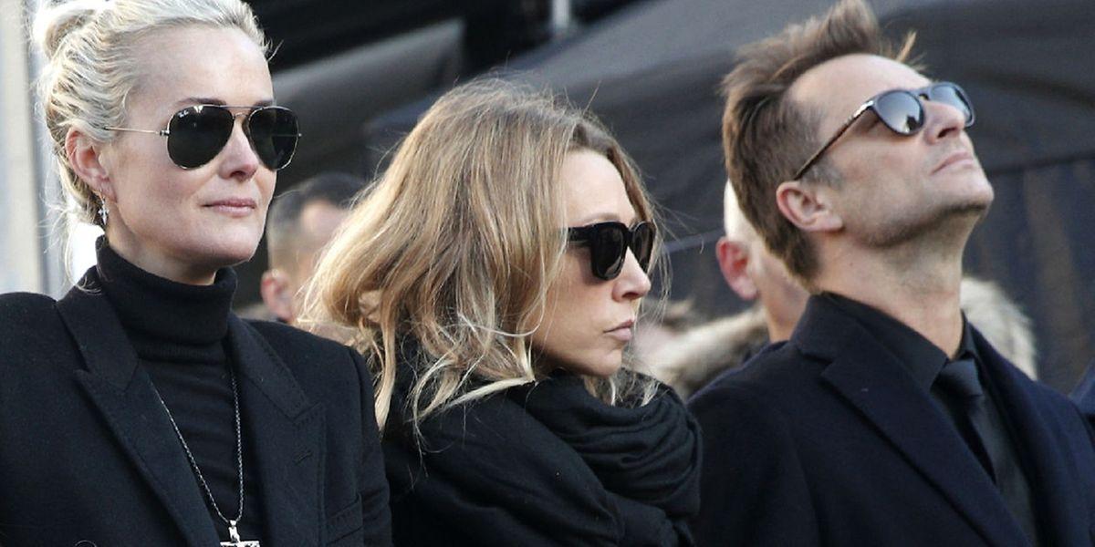 Laeticia Hallyday, Laura Smet et David Hallyday lors des obsèques de Johnny à Paris, le 9 décembre 2017.