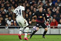 Tottenham Hotspur's Ivorian defender Serge Aurier (L) vies with RB Leipzig's German striker Timo Werner during the UEFA Champions League round of 16 first Leg football match between Tottenham Hotspur and RB Leipzig at the Tottenham Hotspur Stadium in north London, on February 19, 2020. (Photo by Glyn KIRK / IKIMAGES / AFP)