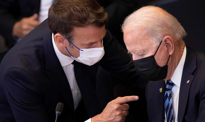Macron (left) in discussion with US President Joe Biden before a NATO meeting in Brussels on Monday