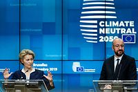 President of the European Commission Ursula von der Leyen (L) and President of the European Council Charles Michel give a press conference during a European Union Summit at the Europa building in Brussels on December 13, 2019. - European Union leaders meet without Britain on December 12, but their departing neighbour's absence will not make agreeing a budget any easier. Inside the chamber, the clash over climate take Brexit's place as the dominant theme of the summit, the first to be chaired by incoming EU Council president Charles Michel. (Photo by KENZO TRIBOUILLARD / AFP)