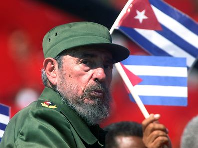 Fidel Castro glances over his shoulder during the May Day commemoration at Revolution Square in Havana, in this May 1, 2004
