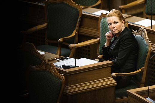 Denmark's Minister of Immigration and Integration Inger Stojberg listen to the debate in the Danish Parliament in Copenhagen on January 26, 2016.