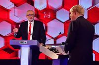 "In this handout photograph taken and released by the British Broadcasting Corporation (BBC) on December 6, 2019, Britain's Prime Minister Boris Johnson (R) and Britain's main opposition Labour Party leader Jeremy Corbyn participate in the BBC Prime Ministerial leaders debate, at the studio in Maidstone, Kent. - Britain will go to the polls on December 12, 2019 to vote in a pre-Christmas general election. (Photo by JEFF OVERS / various sources / AFP) / RESTRICTED TO EDITORIAL USE - MANDATORY CREDIT "" AFP PHOTO / JEFF OVERS-BBC "" - NO MARKETING NO ADVERTISING CAMPAIGNS - DISTRIBUTED AS A SERVICE TO CLIENTS TO REPORT ON THE BBC PROGRAMME OR EVENT SPECIFIED IN THE CAPTION - NO ARCHIVE - NO USE AFTER **DECEMBER 27, 2019** /"